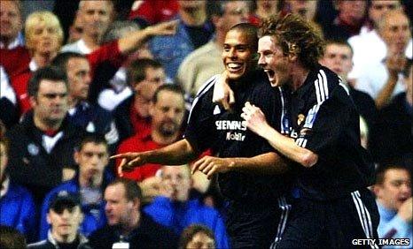 Ronaldo celebrates a goal at Old Trafford with Steve McManaman
