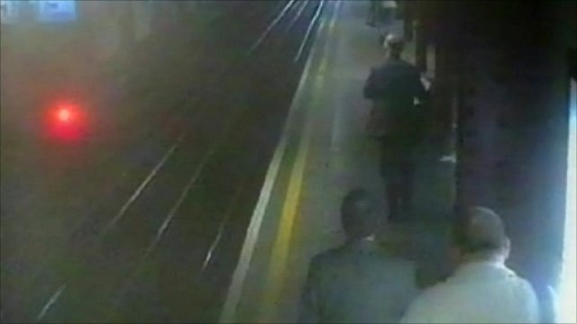 Security camera image showing people on a tube platform