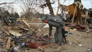 Afghan police man inspect the site of an explosion in Khost, south of Kabul, Afghanistan, Friday, Feb, 18, 2011