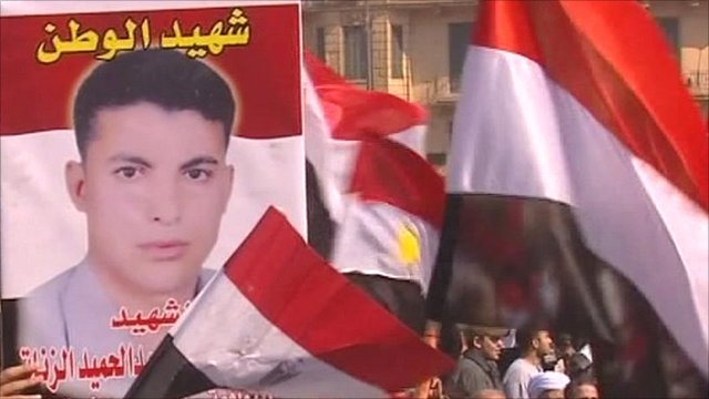 Banners carried by crowds in Cairo