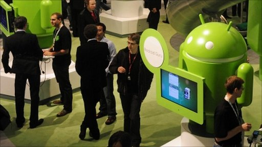 Participants gather around the Google Android stand at the Mobile World Congress in Barcelona