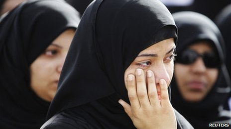 A relative of a protester, who was killed in Thursday's crackdown, mourns during a funeral procession in Sitra, east of Manama, 18 February 2011