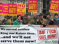 People demonstrating outside the Irish Parliament over proposals to accept a bail from the International Monetary Fund (IMF) and EU