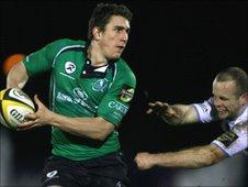 Connacht's Ian Keatley avoids the tackle of Hefin O'Hare