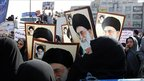 Tens of thousands of Iran regime loyalists, many carrying posters of supreme leader Ayatollah Ali Khamenei, demonstrate in Tehran against opposition leaders on 18 February 2011