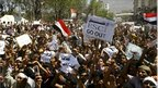 Anti-government protesters shout slogans during a demonstration in the southern Yemeni city of Taiz, 18 February 2011