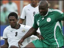 Asamoah Gyan of Ghana and Nigeria's Danny Shittu