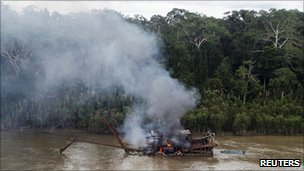 River dredger burning after Peruvian military operation in Madre de Dios region - 19 February 2011