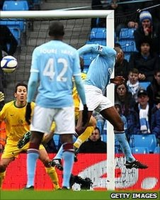 Patrick Viera heads in Manchester City's first goal