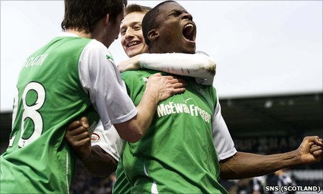 Francis Dickoh celebrates his late goal for Hibernian