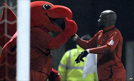 Jonathan Tehoue celebrates Leyton orient's equaliser with Theo ther mascot