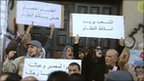 Photo received by AP reportedly showing people chanting and holding signs during a recent unrest in Benghazi, Libya