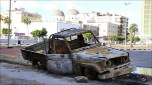 Burnt out car in Benghazi, Libya
