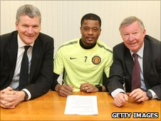 Patrice Evra with Manchester United chief executive David Gill and manager Sir Alex Ferguson