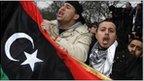 Demonstrators protest against Libya's Muammar Gaddafi outside the Libyan Embassy in London, 20 February 2011