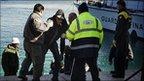 Migrants arrive on Lampedusa, 20 Feb 11