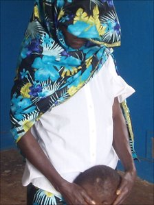 A victim of the mass rape in Fizi on New Year's day, who testified in court, and her child