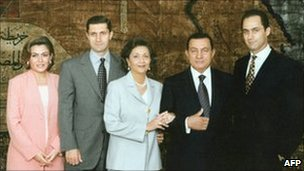 President Hosni Mubarak (2nd right) and his wife Suzanne(centre) pose for a family picture with their two sons Gamal (right) and Alaa (2nd left) and the latter&#039;s wife Heidi al-Sakher (left). File photo 