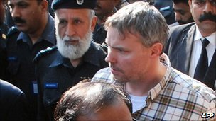 Pakistani police escort arrested US national Raymond Davis to a court in Lahore