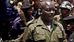 Lt Col Kibibi Mutware exits a mobile military tribunal after being convicted of crimes against humanity in the town of Baraka (21 Feb 2011)