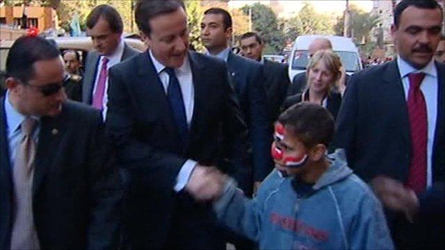 David Cameron meets boy in Cairo