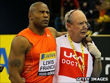 Mark Lewis-Francis is helped from the track