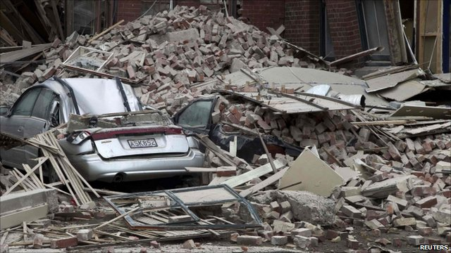 Cars crushed by collapsed building
