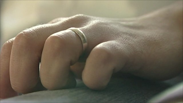 Hand wearing a wedding ring