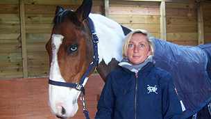 Phoebe Buckley standing next to a horse called Charlie