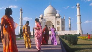 Indian women wearing saris, near the Taj Mahal in Agra, India