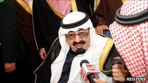 Saudi Arabia's King Abdullah speaks to Saudi media upon his arrival at Riyadh airport, 23 February 2011