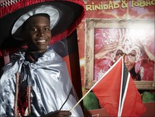Pupil from Trinidad and Tobago dressed in carnival clothes.  Photo copyright Matt Grayson