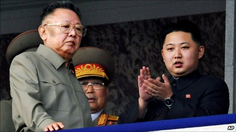 North Korea leader Kim Jong Il, left, walks by his son Kim Jong Un on the balcony as they attend a massive military parade in Pyongyang, North Korea, 10 October 2010