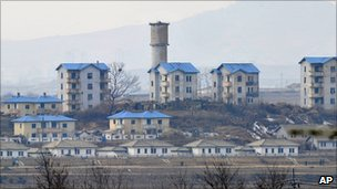 North Korean propaganda village of Gijungdong, seen from South Korea's Taesungdong freedom village, 16 February 2011