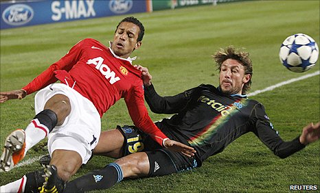 Man Utd winger Nani (left) challenges for a ball with Marseille left-back Gabriel Heinze