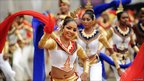 Dancers perform in traditional dress