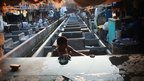 Washing clothes in Dhobi Ghat