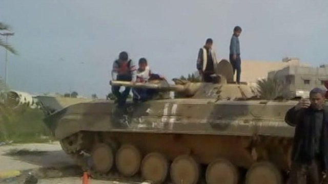 People standing on a disused army tank