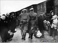 Jews leaving railway trucks during the deportation to concentration camps.