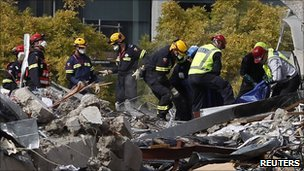 Search crews pull a body from the collapsed CTV building in Christchurch - 24 February 2011
