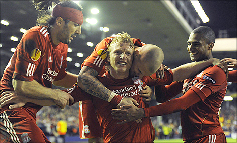 Dirk Kuyt (centre) gets mobbed by team-mates after his winner for Liverpool against Spart Prague