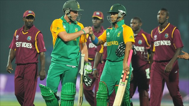 South Africa cricketers AB DeVilliers and JP Duminy celebrate after defeating West Indies