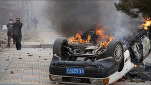 A burning car in Lhasa in March 2008