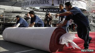 Staff rolling out the red carpet ready for the Oscars