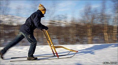 Man kick-sledging