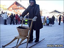 Lady with shopping in her kick-sledge basket
