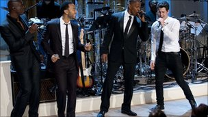 (From left to right) John Legend, Jamie Foxx and Nick Jonas