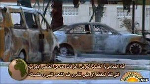 An image grab taken from footage broadcast by the Libyan state television on February 24, 2011 shows burnt cars in Tripoli.
