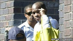 Mziwamadoda Qwabe (R) leaving Wynberg Magistrates' Court on 2 February 2011