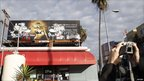 A cartoon of a drunk Mickey Mouse on a billboard in Hollywood